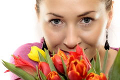 Woman with Colored Tulips Stock Photography