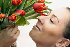 Woman with Colored Tulips. Attractive Woman with Colored Tulips Royalty Free Stock Photo
