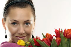Woman with Colored Tulips Stock Images
