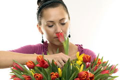 Woman with Colored Tulips. Attractive Woman with Colored Tulips Royalty Free Stock Images
