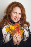 Woman with colorful autumn maple leaves Royalty Free Stock Photos