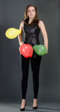 Woman with colorful balloons Royalty Free Stock Photos