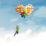 Woman with colorful balloons Royalty Free Stock Images