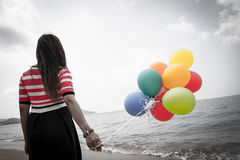 Woman With Colorful Balloons Stock Photography