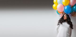Woman with colorful balloons Royalty Free Stock Image