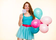 Woman with colorful balloons and lollipop stock photo