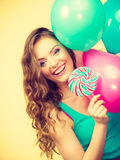 Woman with colorful balloons and lollipop Stock Images