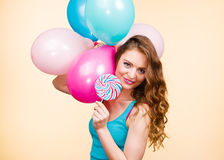 Woman with colorful balloons and lollipop Royalty Free Stock Photography