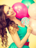 Woman with colorful balloons and lollipop Royalty Free Stock Image