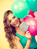 Woman with colorful balloons and lollipop Stock Photography