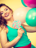 Woman with colorful balloons and lollipop Stock Photos