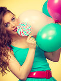 Woman with colorful balloons and lollipop Royalty Free Stock Photos