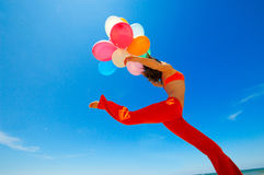 Woman with colorful balloons outdoor Stock Image