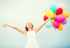 Woman with colorful balloons outside Royalty Free Stock Photography