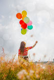 Woman With Colorful Balloons Stock Photos