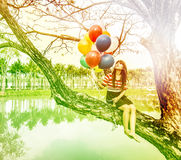 Woman With Colorful Balloons stock images