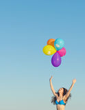Woman with colorful balloons. Stock Images