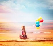 Woman With Colorful Balloons Stock Photo