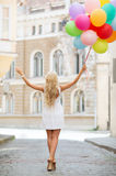 Woman with colorful balloons Stock Image