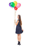 Woman with colorful balloons turning around Stock Images