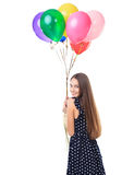 Woman with colorful balloons turning around Stock Photo
