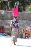 Woman with colorful clothes. ZANZIBAR- TANZANIA OCT 22: Woman with colorful clothes looking for shellfishes on Oct 22 2011,Zanzibar, Tanzania. This activity will Royalty Free Stock Image
