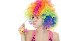Woman in colorful clownish wig over white Royalty Free Stock Photography