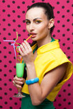 Woman with colorful cocktail Stock Image