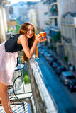 Woman with colorful coffee cup on the balcony Royalty Free Stock Image