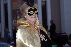 Woman in Colorful Costume in Mardi Gras Parade. Woman wearing colorful costume, marches in Mardi Gras Parade stock photo