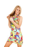 Woman colorful dress play with hair serious Stock Photo