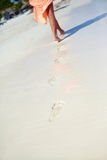 Woman in colorful dress walking on beach ocean Royalty Free Stock Images