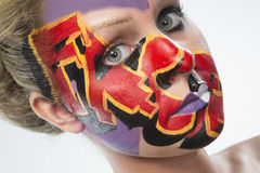 Woman with colorful face paint Royalty Free Stock Photos