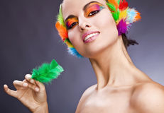 Woman with colorful feathers in hair Stock Photos