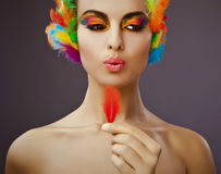 Woman with colorful feathers Royalty Free Stock Photo