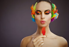 Woman posing with colorful feathers Royalty Free Stock Photography