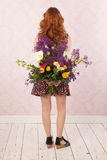 Woman with colorful flowers Stock Photos