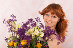 Woman with colorful flowers Royalty Free Stock Image