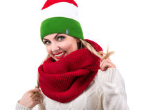 Woman in colorful hat and scarf, smiling.Girl with braces. Beautiful warm knitted things.Scarf wrapped around the head royalty free stock images