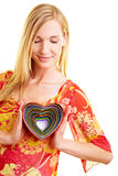 Woman with colorful heart Royalty Free Stock Photos