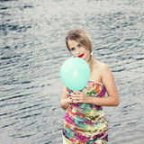 Woman  with colorful latex balloon Royalty Free Stock Photo