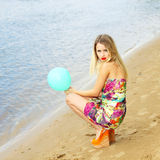 Woman  with colorful latex balloon Stock Photography