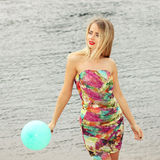 Woman  with colorful latex balloon Stock Photos