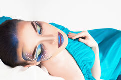 Woman with colorful make-up and crystals. Beautiful woman with colorful make-up, crystals and drawing on face Royalty Free Stock Photo