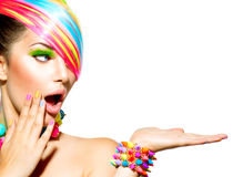 Woman with Colorful Makeup. Beauty Woman with Colorful Makeup, Hair, Nails and Accessories royalty free stock image