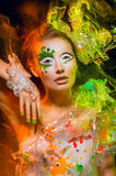 Woman with colorful makeup Stock Images