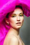 Woman with colorful makeup Stock Image