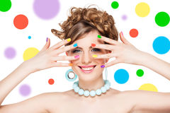 Woman with colorful  nail polish Stock Images