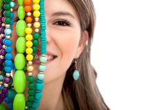 Woman with colorful necklaces Stock Images