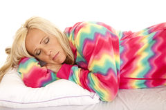 Woman in colorful pajamas lay asleep Royalty Free Stock Image